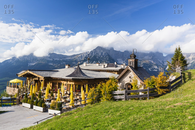 May 30, 2018: Brenneralm and little chapel in front of the mountain range 'wilder kaiser'