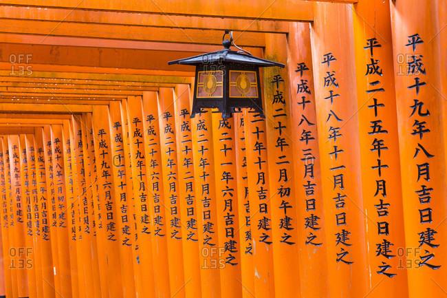 May 30, 2018: Path through ornate torii gates at fushimi-inari taisha, shinto shrine