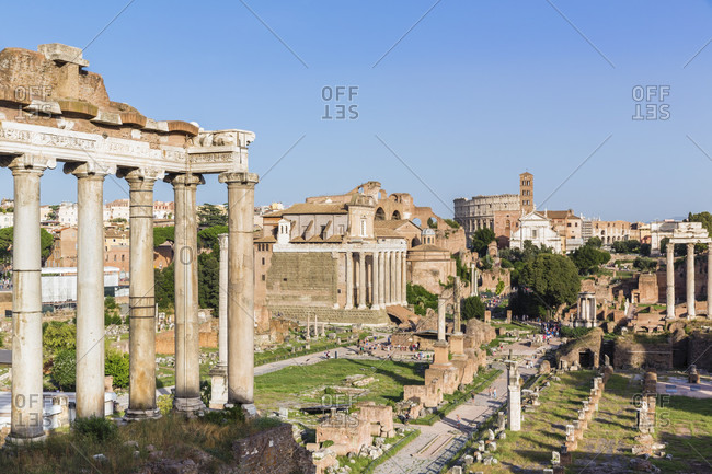May 30, 2018: Roman forum, temple of saturn and view to the colosseum, unesco world heritage site
