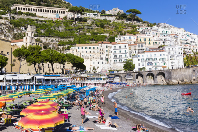 May 30, 2018: Colorful sun umbrellas on the beach in front of amalfi