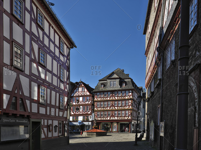 March 23, 2020: Europe, germany, hesse, lahn-dill-bergland nature park, city of herborn, market square, view from bahnhofstrasse to the market square with the nassauer haus (market 2), four-story half-timbered house with flat carvings, built in 1728, market fountain