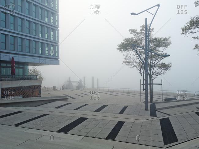 October 10, 2018: Harbor city hamburg by haze, hamburg, germany, europe