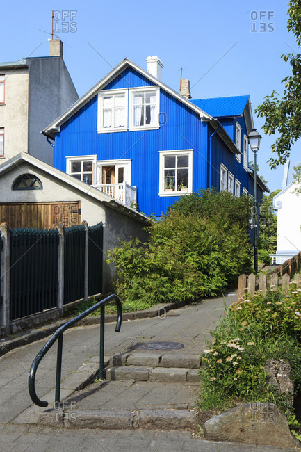 Blue house in an alley in reykjavik, iceland