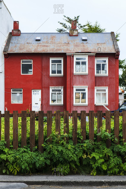Red house with front yard in reykjavik, iceland