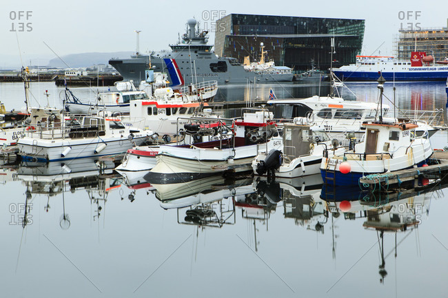 July 11, 2019: Reykjavik marina with harpa opera house in the background.