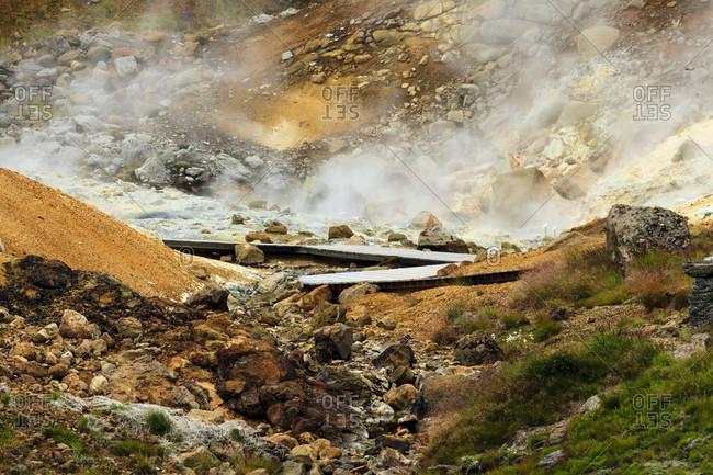 Boardwalk over steaming ground, mineral deposits, seltún geothermal area, iceland