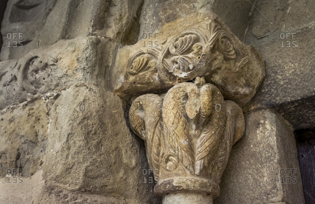 Capital of the notre dame de l'assomption church in rieux minervois. the scallop indicates that rieux was once a side road of the way of st. james. the church was built in the xii century. monument historique.