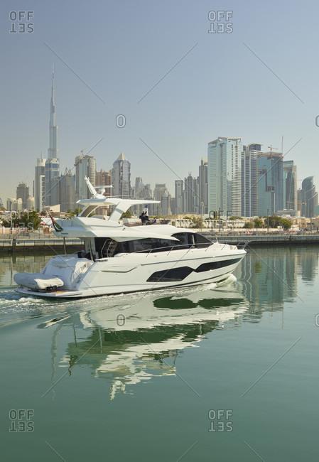 January 16, 2020: Yacht in dubai creek, burj khalifa, dubai, united arab emirates