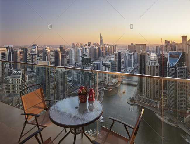 January 16, 2020: View from an apartment over the dubai marina, table with chairs, terrace, dubai, united arab emirates