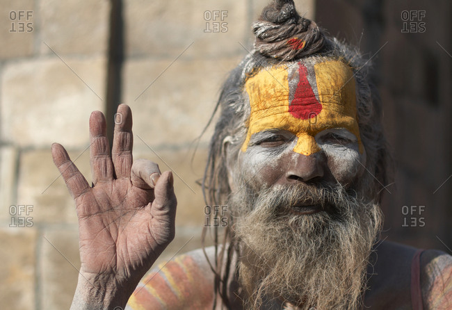 Nepal - September 9, 2020: Hindu sadhu giving the Mudra hand gesture meaning no fear at Pashupatinath temple in Kathmandu