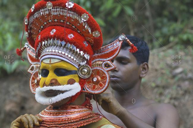 Kerala, India - September 9, 2020: Hindu man dresses as Vishu before the Theyyam ritual at a temple in Kannur, Kerala