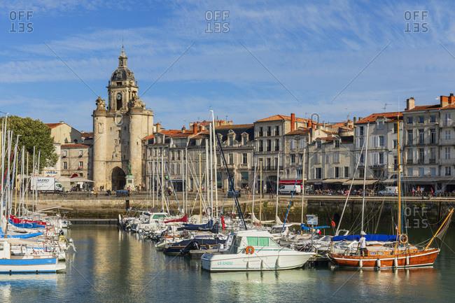 France - July 28, 2018: The Old Harbor (Vieux Port), Grosse Horloge clock