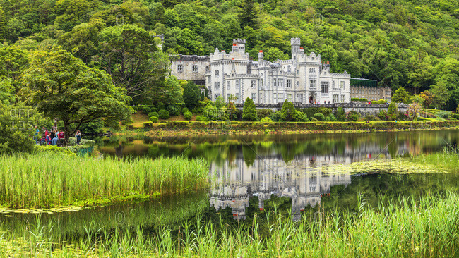 Galway, Ireland - July 15, 2018: Kylemore Abbey, Neo Gothic building on the shores of Kylemore Lake