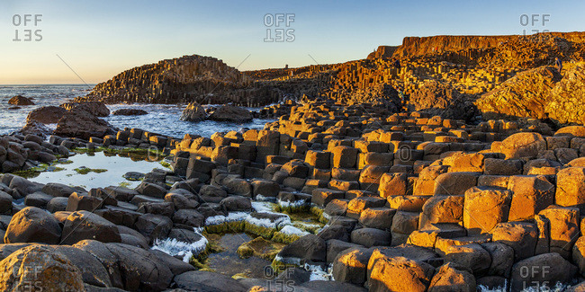 Coastal landscape with basaltic rock formations along the Causeway Coastal Route