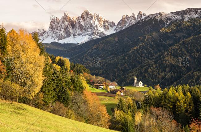 Italy - November 3, 2018: San Giacomo Church and Odle range (Geislergruppe) in background