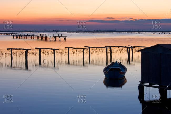 Sacca degli Scardovari, fishing boats and nets at sunset