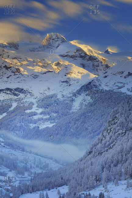 Lyskamm Orientale and the valley at dawn after a snowfall