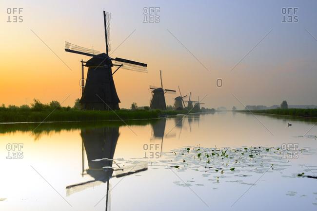 Windmills in Kinderdijk at sunset