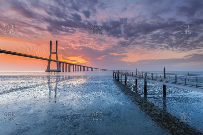 Ponte Vasco da Gama Bridge across Tagus River at sunrise