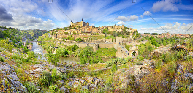 Panoramic view over Alcazar de Toledo and Puente de Alcantara over Tagus river