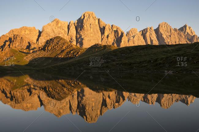 Pale di San Martino reflected in the little lake of Cima Caladora