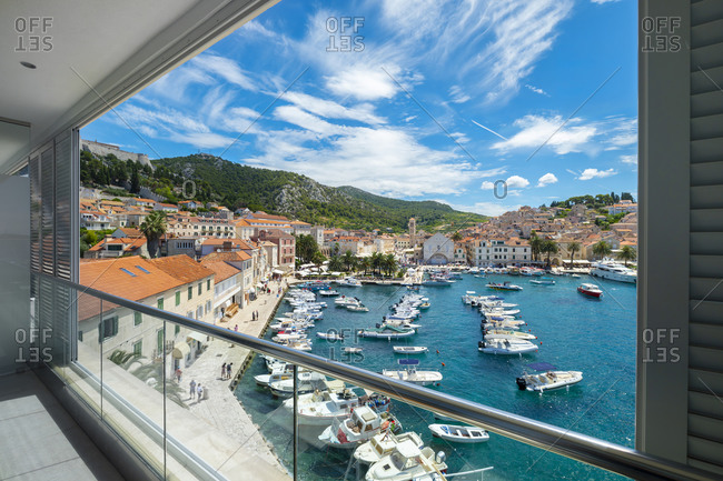 Croatia - June 28, 2018: View on the harbor and the village from the terrace of a suite of the Adriana hotel