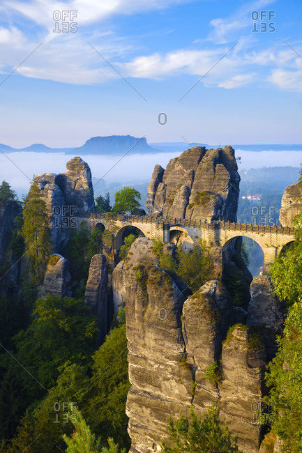 Dawn on the bridge of the Bastei rocks and the Mt Lilienstein in background