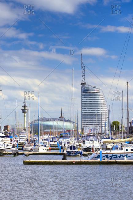 Germany - June 19, 2018: Sail City building, altter hafen and skyline of Havenwelten-district