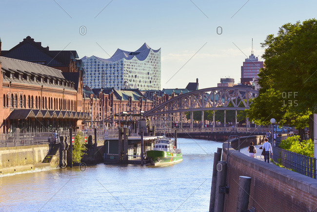 Germany - June 28, 2018: Elbe Philharmonic Hall and Elbe river with Deutsches Zollmusem along Neuer Wandrahm street.