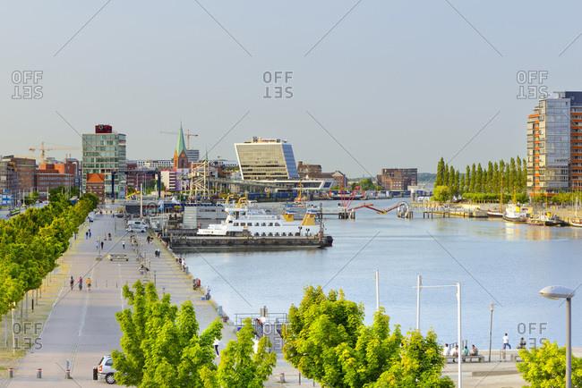 Germany - July 20, 2018: View over Kiel harbor with Schwedenkai and Ostseekai with St. Nikolai zu Kiel church and surrounding waterfront buildings.