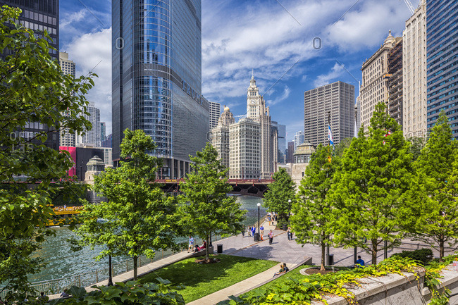 Chicago, Illinois - June 20, 2015: Downtown, Loop, Chicago Riverwalk, with the Trump International Hotel and Tower and the Wrigley Building in the background