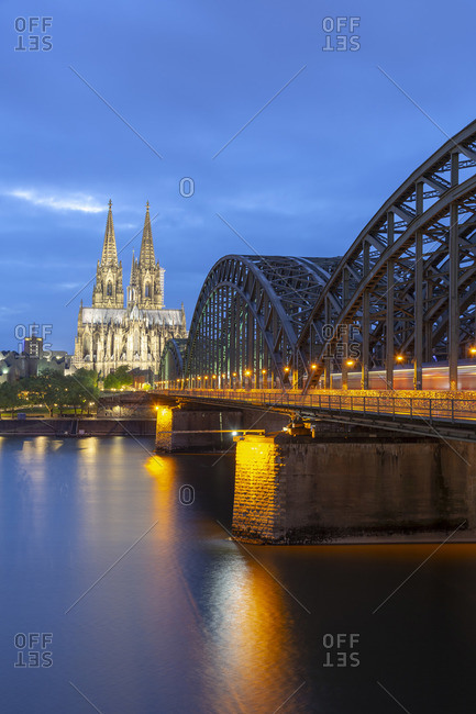 Germany - April 27, 2019: Cologne Cathedral and Hohenzollern Bridge on River Rhine