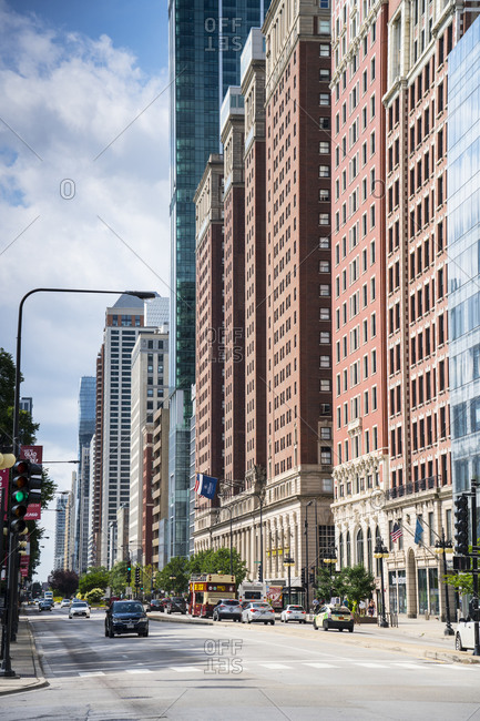 Chicago, Illinois - August 22, 2019: Michigan Avenue skyscrapers in front of Millennium Park