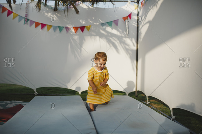 A little girl playing inside a Jewish sukkah