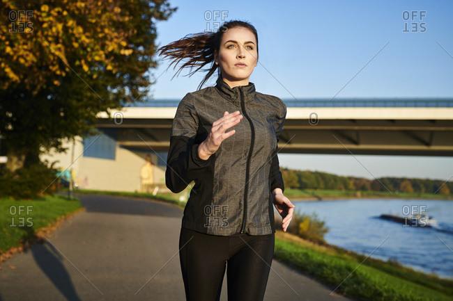 Portrait of sportive woman jogging
