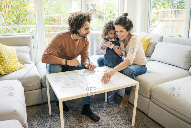 Family sitting on couch - playing memory game