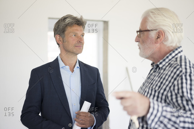 Man in suit and senior man talking