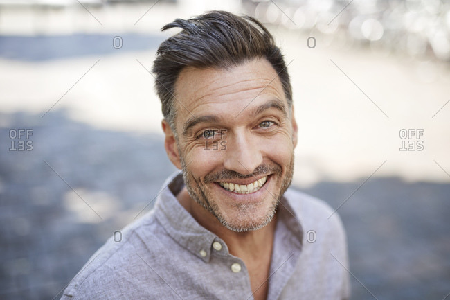 Portrait of laughing mature man with stubble
