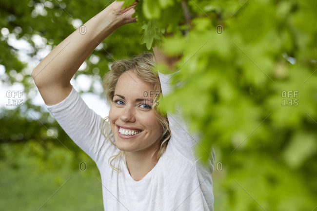Portrait of relaxed blond woman in nature