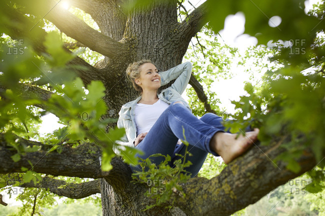 Smiling blond woman relaxing in nature