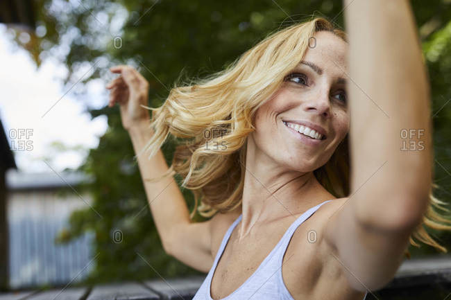 Carefree, smiling blond woman outdoors