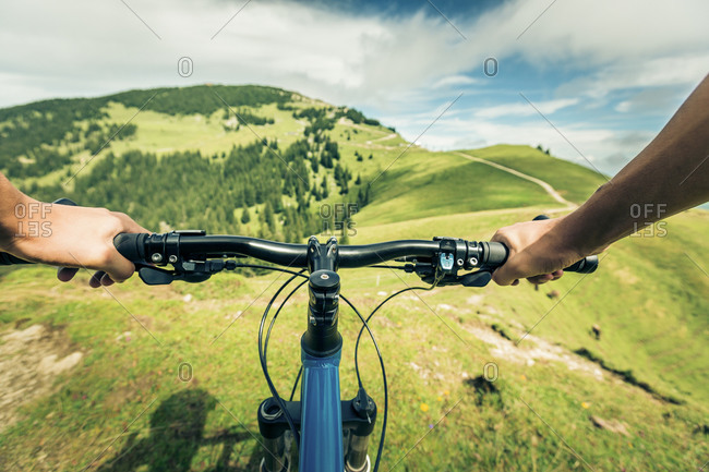 Germany- Bavaria- Pfronten- mountainbiker riding downhill on alpine meadow near Aggenstein