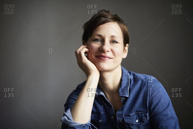 Portrait of an attractive woman- wearing denim shirt