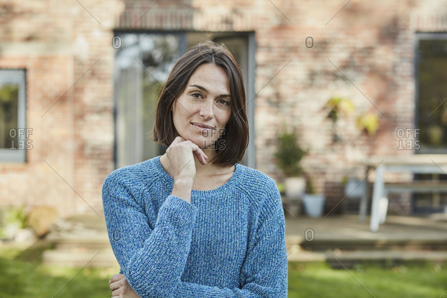 Portrait of confident woman in garden of her home