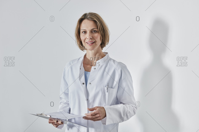 Portrait of female doctor with anamnesis questionnaire