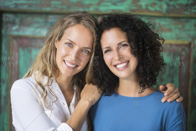 Portrait of two smiling women side by side