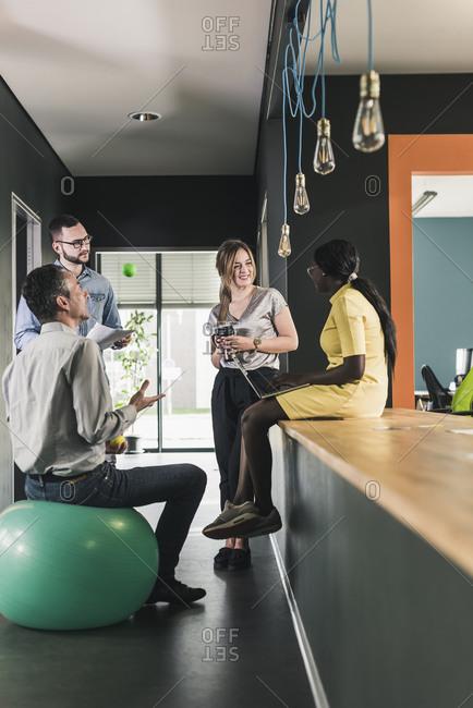 Business people having an informal meeting in office