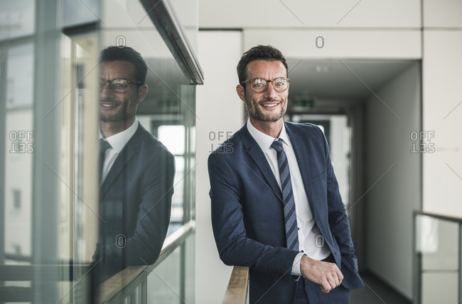 Portrait of a successful businessman- standing in office building