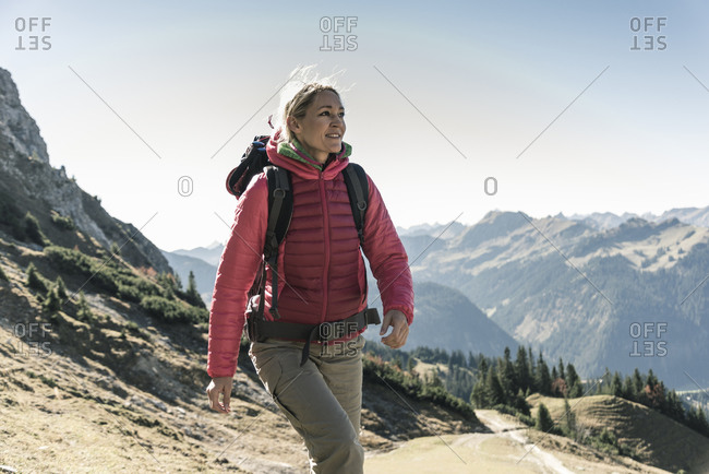 Austria- Tyrol- smiling woman on a hiking trip in the mountains
