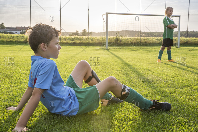 Two young football players on football ground